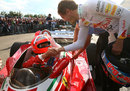 Sebastian Vettel wishes Niki Lauda luck before he heads out on a lap in his old Ferrari 312 T2