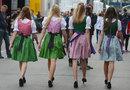 Grid girls walking through the paddock