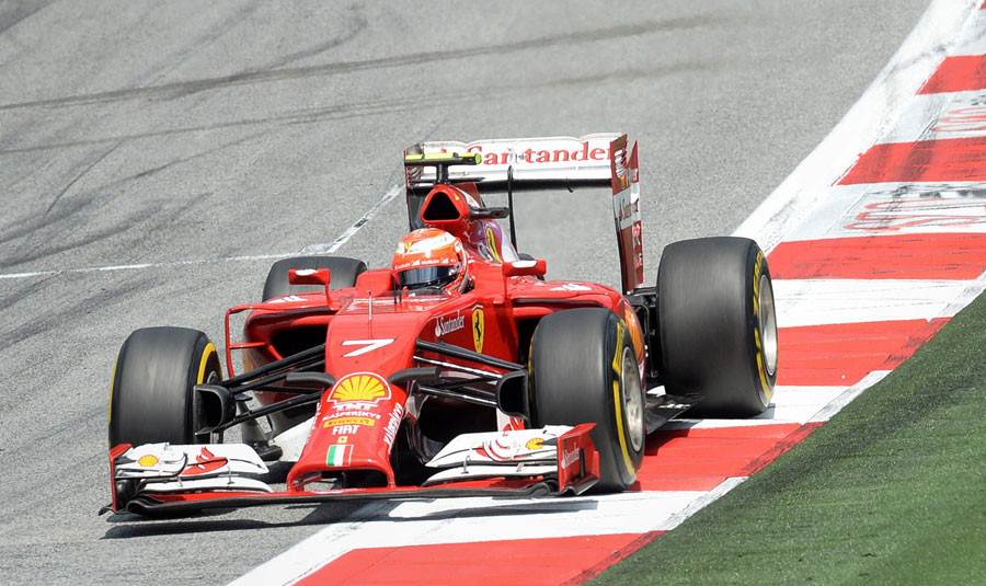 Kimi Raikkonen uses the kerb as he comes out of the final corner