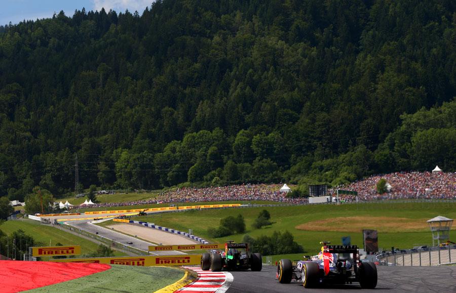 Daniel Ricciardo chases down Nico Hulkenberg