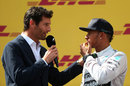 Mark Webber interviews Lewis Hamilton on the podium