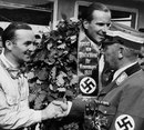 Richard Seaman on top of the podium after winning the German Grand Prix ahead of Hermann Lang