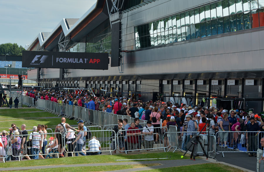 Fans pack into the pit lane to get up close and personal with the drivers on Thursday