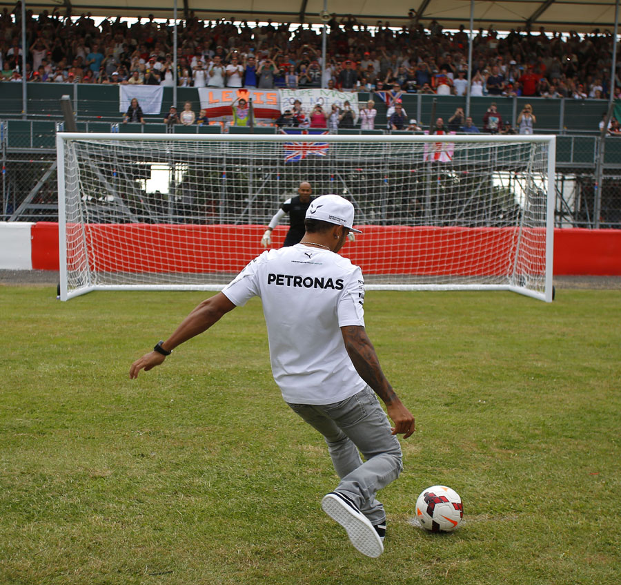 Lewis Hamilton shows off his football skills in front of a packed crowd