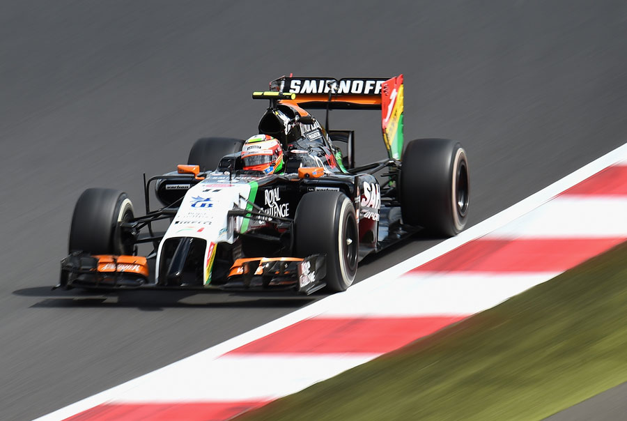 Sergio Perez approaches a kerb on Friday