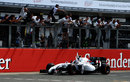 Valtteri Bottas celebrates as he crosses the line for a career-high second position