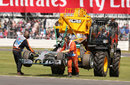 Nico Rosberg's Mercedes gets lifted away after a gearbox issue