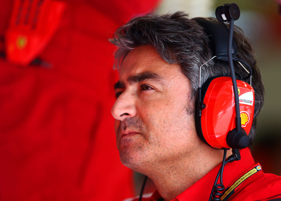 Marco Mattiacci watches on from the Ferrari garage