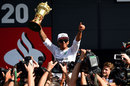 Lewis Hamilton celebrates with the RAC trophy