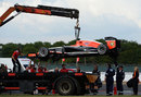 Jules Bianchi's Marussia is lifted onto a flatbed truck after a small fire stopped it on track