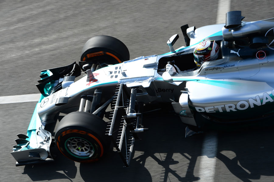 Lewis Hamilton leaves the pits with an aero sensor on his Mercedes