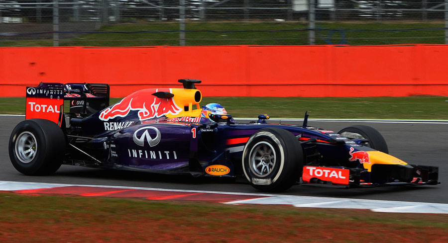 Sebastian Vettel puts his Red Bull and its test Pirelli tyres through their paces