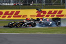 Esteban Gutierrez loses a wing plate as he clips Pastor Maldonado on the approach to Club Corner