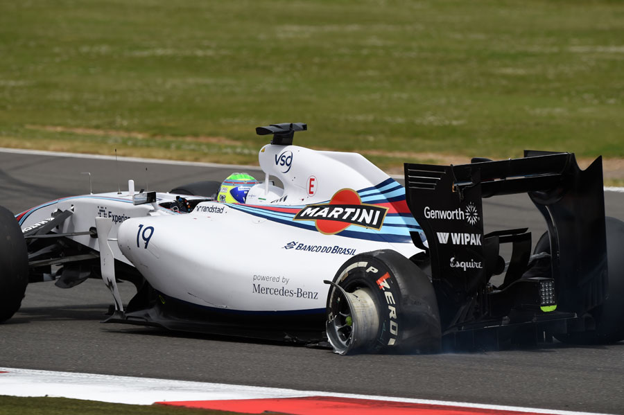 Felipe Massa limps around the circuit after being caught up in the first-lap crash