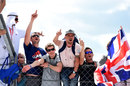 British fans climb the fence to celebrate Lewis Hamilton's victory