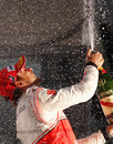 Champagne flies as Jenson Button celebrates victory
