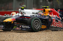 Mark Webber ends up in the gravel as Lewis Hamilton slips by