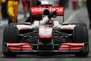 Jenson Button celebrates his win coming down the pit lane