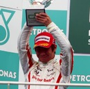 Kamui Kobayashi  celebrates his second position in the GP2 Asia Series at Sepang in 2009