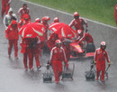Soggy Ferrari mechanics head back to the pits