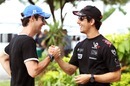 HRT driver Bruno Senna with Virgin Racing's Lucas di Grassi in the Sepang paddock