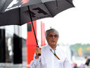 Bernie Ecclestone arrives in a wet paddock on Sunday morning