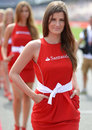 A grid girl on track before the race