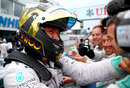 Nico Rosberg celebrates victory with his team
