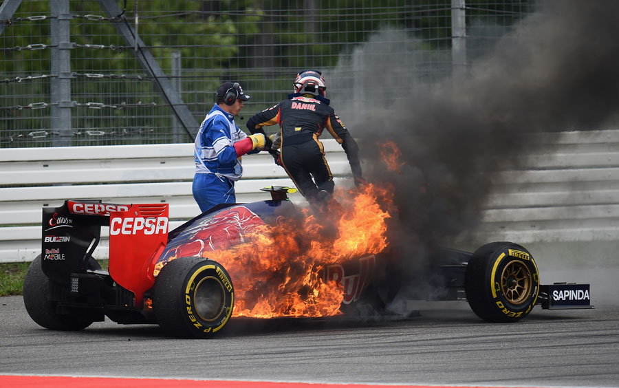 Daniil Kvyat jumps from his flaming Toro Rosso at Turn 6