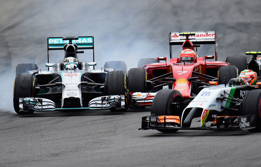 Lewis Hamilton and Kimi Raikkonen make contact on the run down to the hairpin