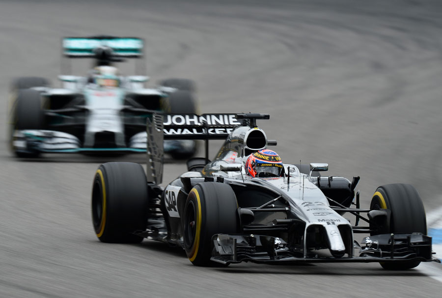 Jenson Button on track with Lewis Hamilton in close company