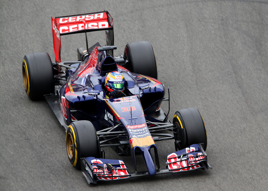 Jean-Eric Vergne angles his Toro Rosso car towards the apex
