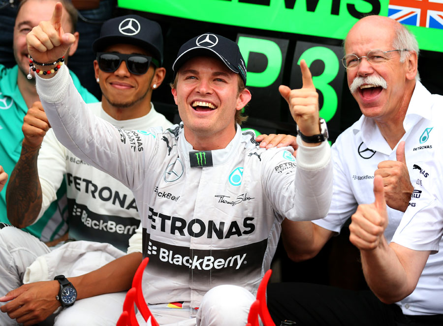 Nico Rosberg celebrates victory with the Mercedes team