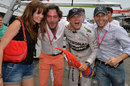 Nico Rosberg celebrates victory with friends outside the Mercedes garage