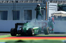 Kamui Kobayashi jumps clear of his smoking Caterham