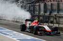 Max Chilton returns to the pits with smoke coming from the rear of his Marussia