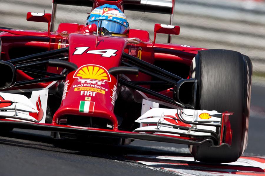 Fernando Alonso hops across the kerbs in his Ferrari