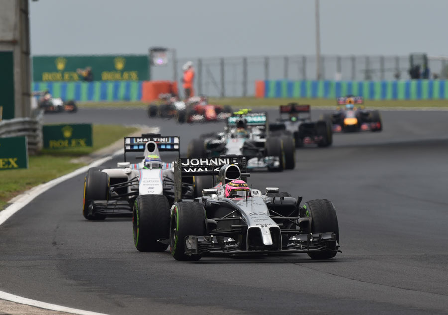 Jenson Button on the opposite tyre to the rest of the field