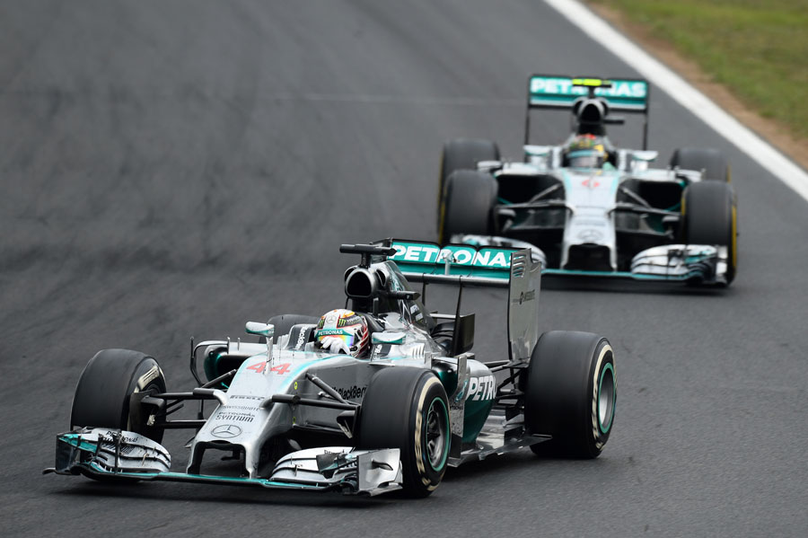 Lewis Hamilton driving with Nico Rosberg in close company