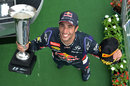 Daniel Ricciardo poses for photographs on the podium
