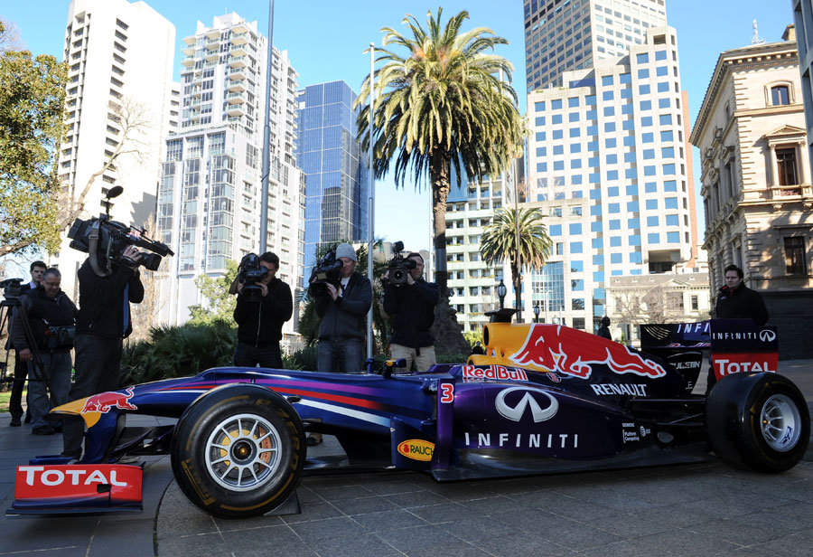TV cameras gather around a Red Bull F1 car as Melbourne announces an extension of its F1 contract until 2020