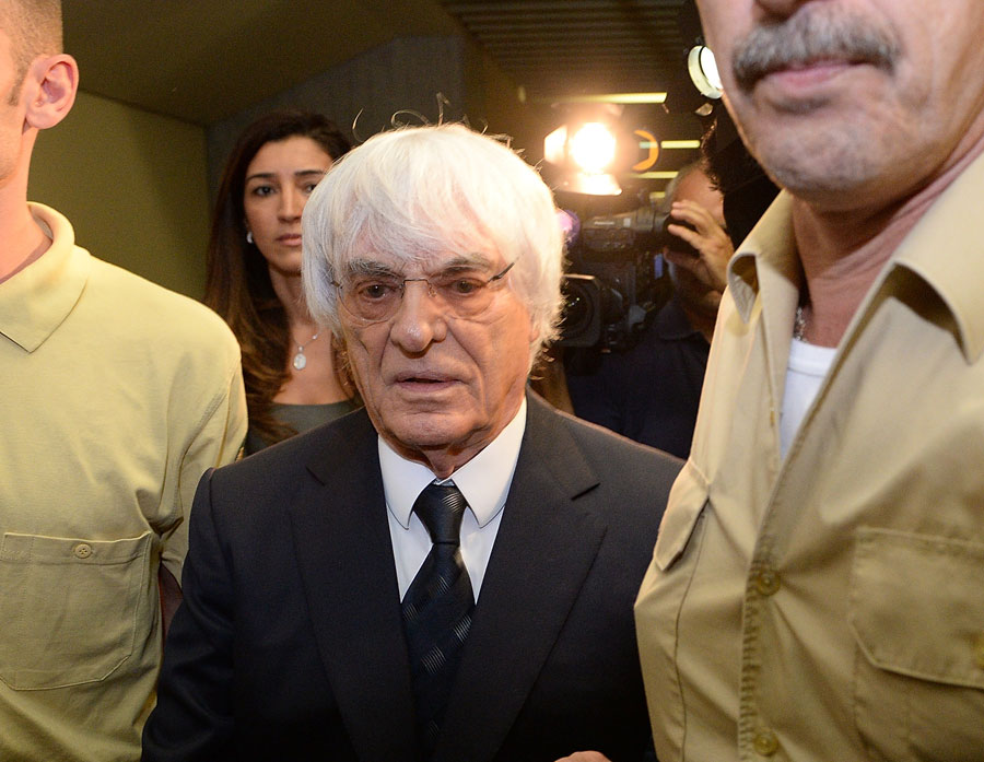 Bernie Ecclestone leaves court after a judges agreed to conclude his trial for bribery