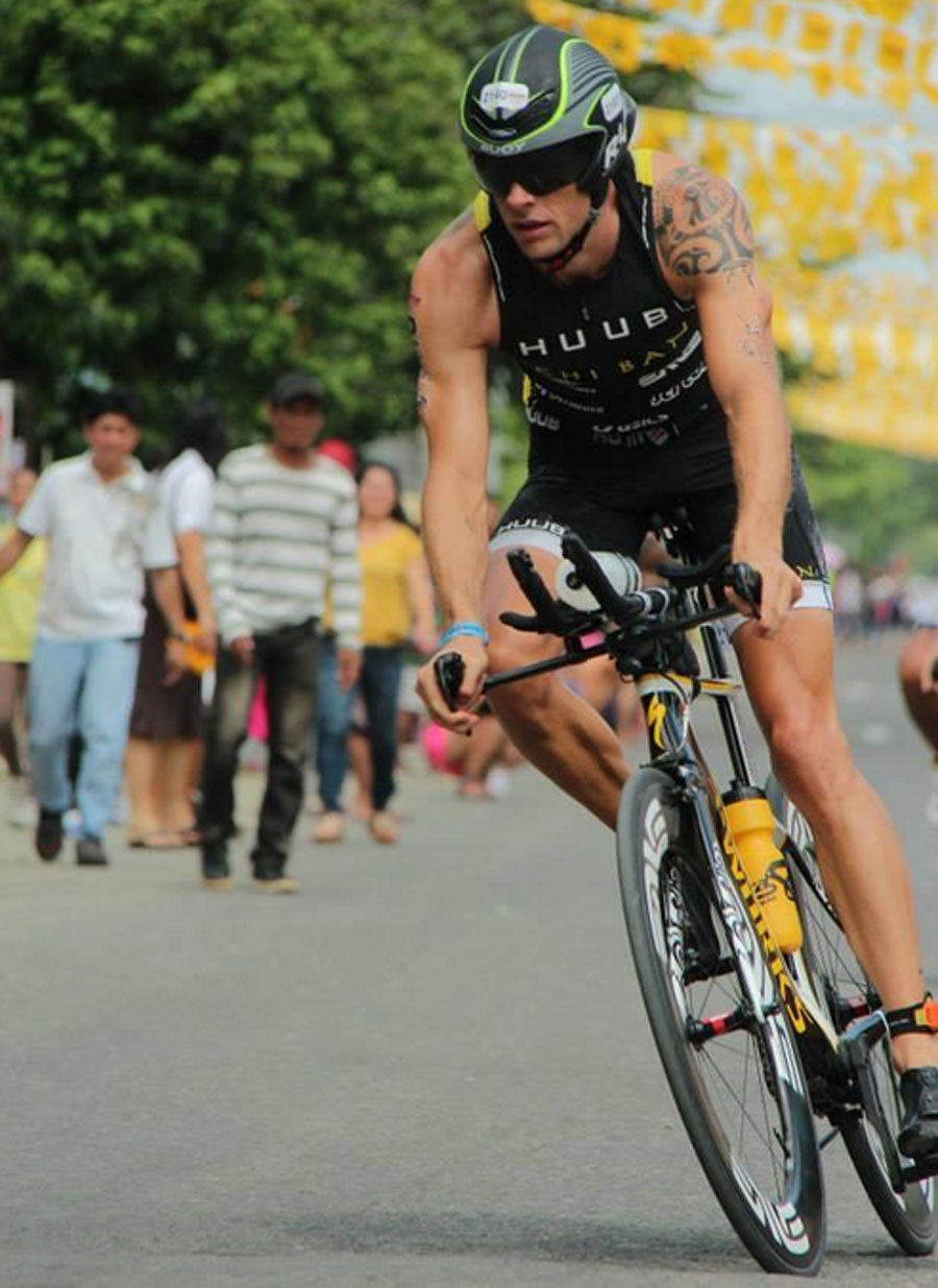Jenson Button during the cycling stage of the Ironman 70.3 Cebu, where he finished 11th