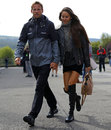 Jenson Button arrives in the paddock with fiancée Jessica Michibata