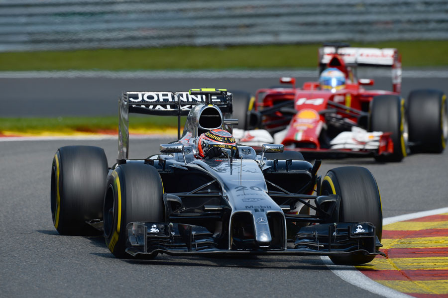 Kevin Magnussen leads Fernando Alonso through Les Combes