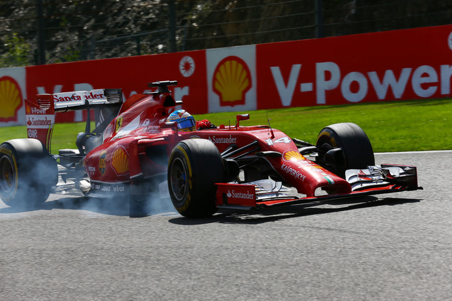 Fernando Alonso snatches at a brake