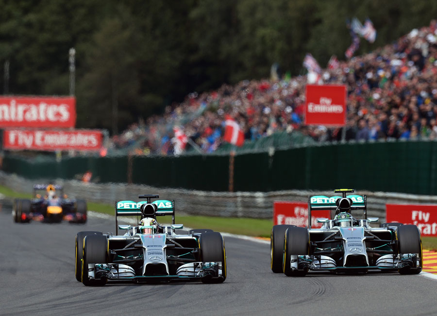 Nico Rosberg and Lewis Hamilton on the run to Les Combes