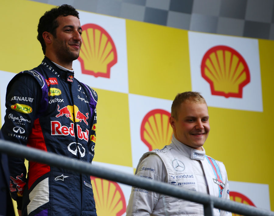 Race-winner Daniel Ricciardo and Valtteri Bottas are all smiles on the podium