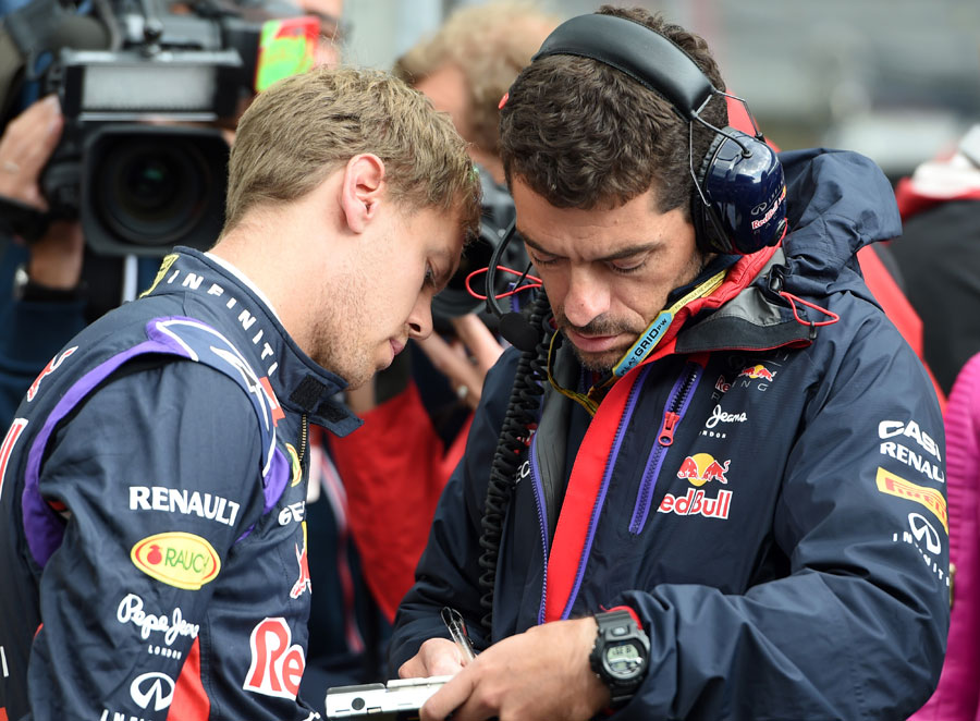 Sebastian Vettel and Guillaume Rocquelin in discussion ahead of the race