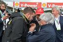 Bernie Ecclestone talks with Pirelli's Paul Hembery and Niki Lauda on the grid